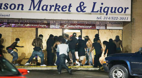 Looters use Ferguson riots as an excuse to rob a liquor store.
